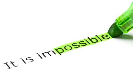 infeasible: The word possible highlighted in green as a part of the word impossible Stock Photo