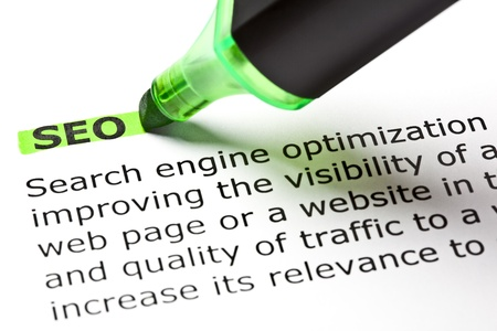 optimize: SEO highlighted in green with felt tip pen Stock Photo
