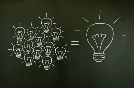 idea light bulb: Many small ideas equal a big one, illustrated with chalk drawn light bulbs on a blackboard.
