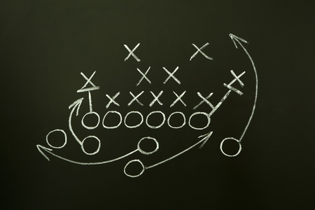strategy: Estrategia de juego dibujada con tiza blanca en una pizarra. Foto de archivo