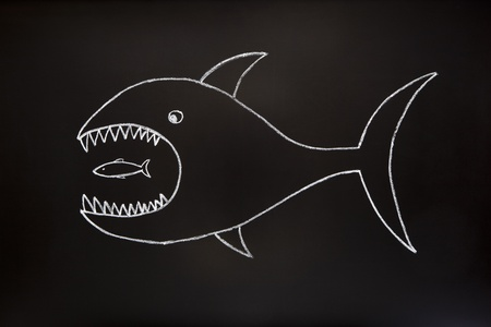 absorption: The big fish eats the small one. Conceptual image made with chalk on a blackboard.