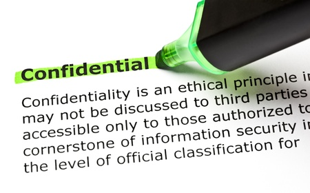 confidentiality: The word CONFIDENTIAL highlighted in green with felt tip pen