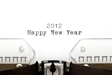 typebar: Concept image with 2012 HAPPY NEW YEAR written on an old typewriter