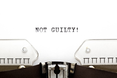 typebar: Concept image with NOT GUILTY! written on an old typewriter Stock Photo