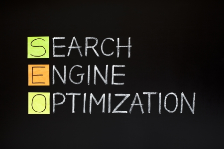keywords link: SEO acronym - SEARCH ENGINE OPTIMIZATION made with sticky notes and white chalk on a blackboard