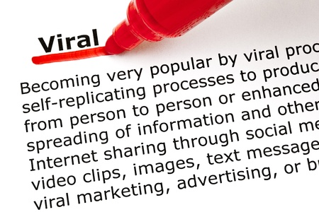 viral: The word Viral underlined with red marker on white paper. Stock Photo
