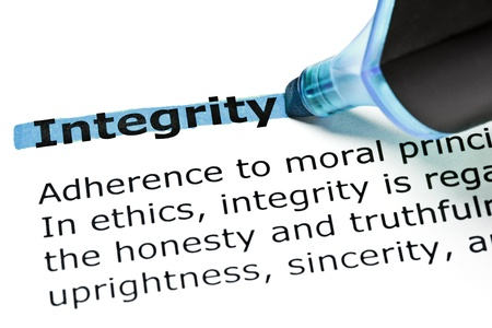 The word Integrity highlighted in blue with felt tip pen photo