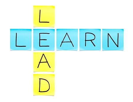 Learn-Lead crossword made with sticky notes on white background photo