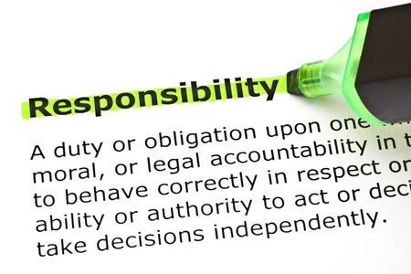 Definition of the word Responsibility highlighted in green with felt tip pen Stock Photo