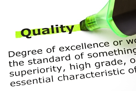 Definition of the word Quality highlighted in green with felt tip pen photo