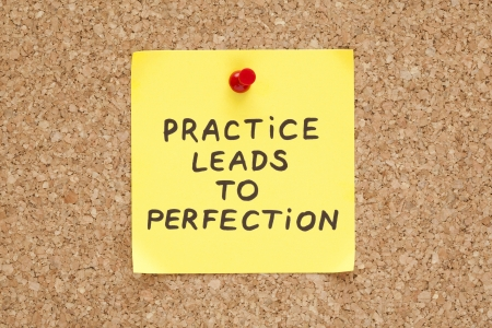 leads: Practice leads to perfection, written on an yellow sticky note on a cork bulletin board Stock Photo