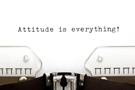optimist: Attitude is Everything printed on an old typewriter
