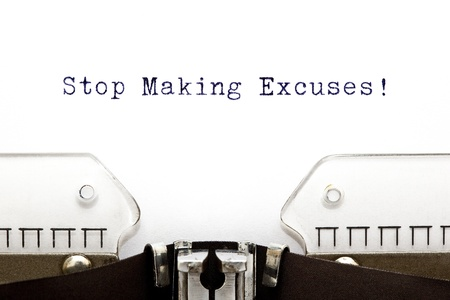 accountability: Stop Making Excuses printed on an old typewriter