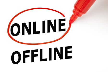 Choosing Online instead of Offline. Online selected with red marker. Stock Photo - 17150358