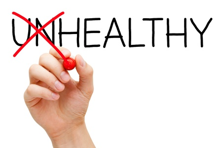 Hand turning the word Unhealthy into Healthy with red marker isolated on white. Stock Photo - 17195613