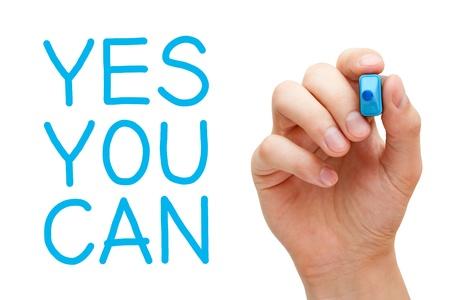 you can: Si usted puede y mano que sostiene marcador azul.