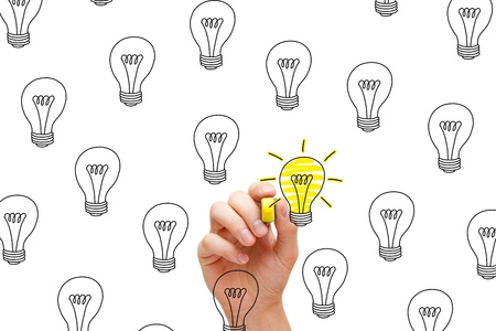 few: So many ideas, but only a few are great. One glowing light bulb among many. Stock Photo