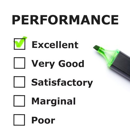 Performance evaluation form with green check mark on Excellent with felt tip pen. photo