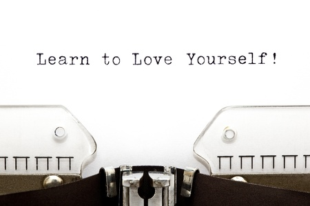 self development: Learn To Love Yourself printed on an old typewriter