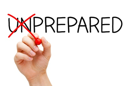 improve: Hand turning the word Unprepared into Prepared with red marker isolated on white.