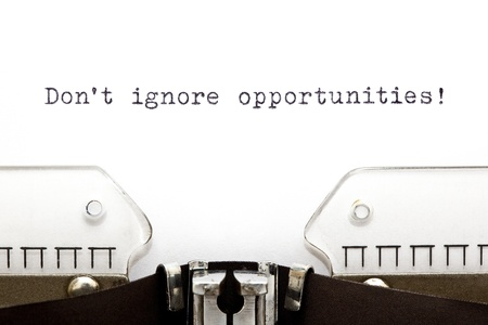 Don't Ignore Opportunities printed on an old typewriter. Stock Photo - 17970174