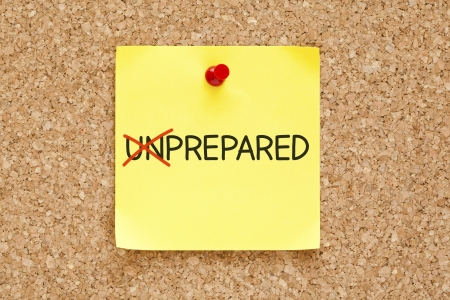 eagerness: Turning the word Unprepared into Prepared with red marker on yellow sticky note pinned with red push pin. Stock Photo