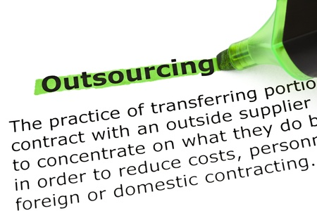 outsourcing: Definition of the word Outsourcing, highlighted in green with felt tip pen. Stock Photo