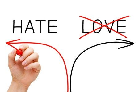 hate: Hand drawing Hate concept with marker on transparent wipe board. Choosing Hate instead of Love. Stock Photo