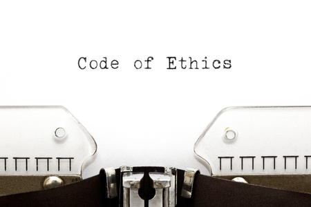 ethics: Code of Ethics printed on an old typewriter.