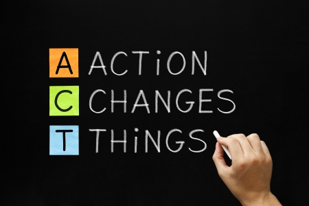 proactive: Hand writing Action Changes Things with white chalk on blackboard. Stock Photo