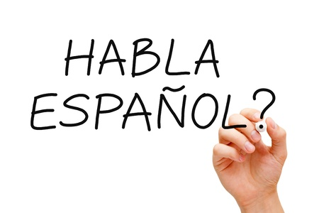 spaniard: Hand writing Habla Espanol? question with black marker on transparent wipe board.