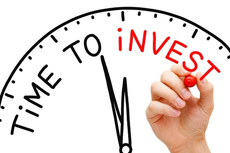 investment goals: Hand writing Time to Invest concept with red marker on transparent wipe board. Stock Photo