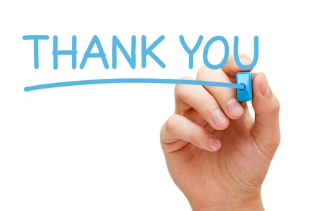 Hand writing Thank You with blue marker on transparent wipe board. photo
