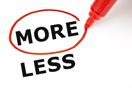 less: Choosing More instead of Less. More selected with red marker. Stock Photo