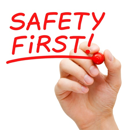 Hand writing Safety First with red marker on transparent wipe board. Stock Photo - 19055817