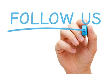 follow us: Hand writing Follow Us with blue marker on transparent wipe board.