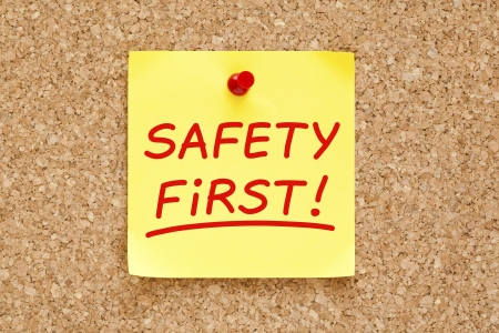 Safety First written on yellow sticky note with red marker. Stock Photo - 19250886