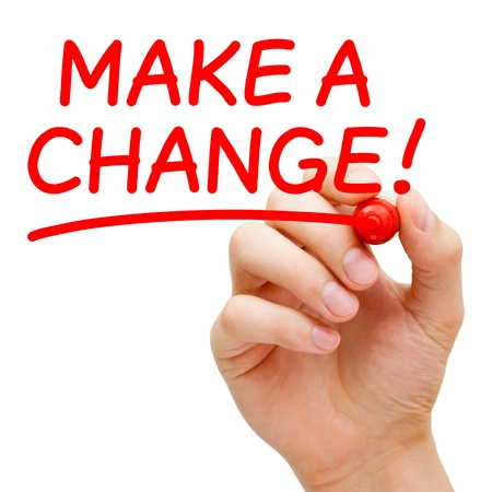 Hand writing Make a Change with red marker on transparent wipe board. Stock Photo - 19408605