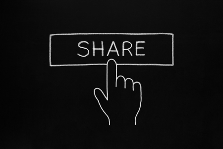telling: Hand clicking Share button drawn with white chalk on blackboard.