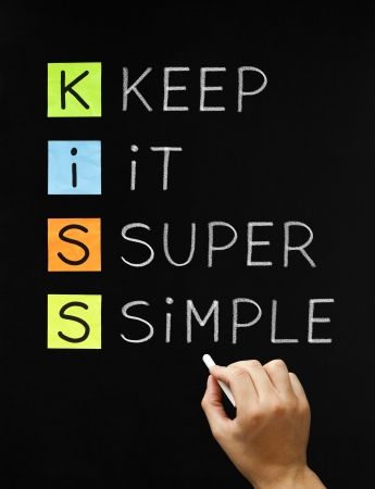 mere: Hand writing Keep It Super Simple with white chalk on blackboard. Stock Photo