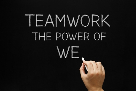 we: Hand writing Teamwork - The Power Of We with white chalk on a blackboard.