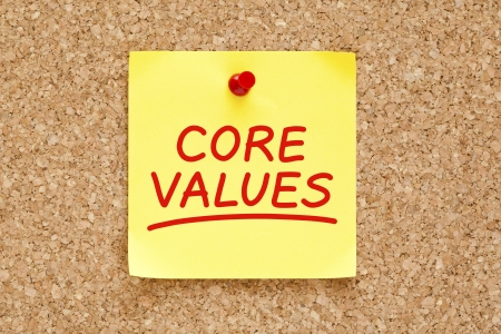 Core Values written on yellow sticky note with red marker. photo
