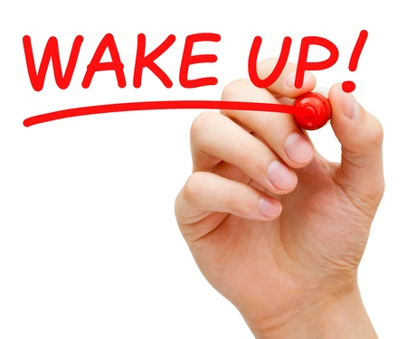 arouse: Hand writing Wake Up with red marker on transparent wipe board. Stock Photo