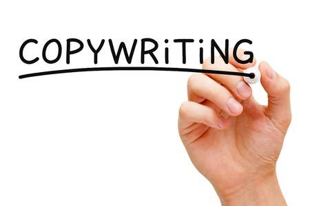 copywriting: Hand writing Copywriting with black marker on transparent wipe board.