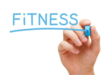 health: Hand writing Fitness with blue marker on transparent wipe board.