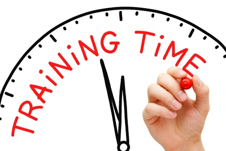 Hand writing Training Time concept with red marker on transparent wipe board. Stock Photo