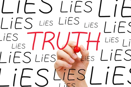 untruth: Hand writing Truth with red marker between many Lies on transparent wipe board.