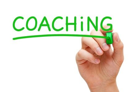 Hand writing Coaching with green marker on transparent wipe board. Stock Photo