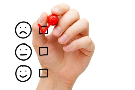 unsatisfied: Hand putting check mark with red marker on poor customer service evaluation form. Stock Photo