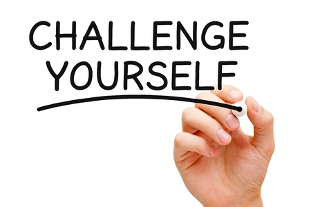 overcome a challenge: Hand writing Challenge Yourself with black marker on transparent wipe board. Stock Photo